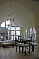 A stylish leisure are using a Heritage garden room with plaster finish to vaulted ceiling and hardwood doors and windows