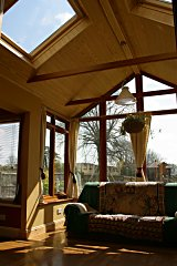 A vaulted ceiling with knotless tongue and groove timber and large skylights created the ideal solution.