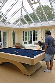 A bright and airy games room ideal for keeping budding snooker champs out of sight.